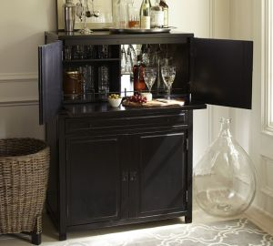 We all need a place to keep our collection or at least the ones we use the most. The Clyde Bar will hold everything you need for effortless entertaining. A mirrored back reflects the bar's contents for a striking display. Available here.